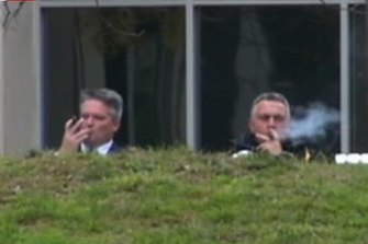 Mathias Cormann and Joe Hockey kick back with a cigar in 2014.