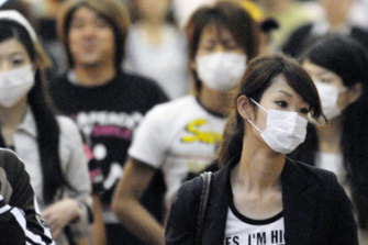 Shoppers in Japan wear masks as precaution against germs.
