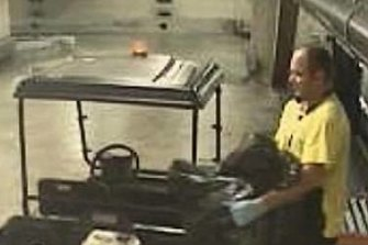Maintenance worker Anthony Parker loading garbage bags full of cocaine at Sydney Airport.
