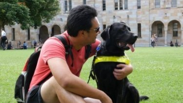 Jefferson is studying for his masters in clinical psychology at the University of Queensland with the help of his four-year-old black labrador, Ice.