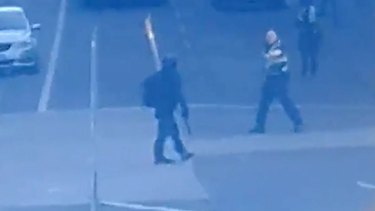 A screenshot of footage taken by a Twitter user reportedly showing the suspect dressed in black.