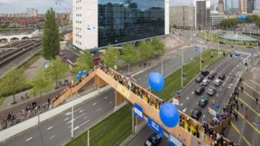 The Luchtsingel pedestrian bridge in Rotterdam shows what can be done with crowdsourced infrastructure.