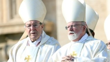 Cardinal George Pell (left) and Archbishop of Boston Cardinal Sean Patrick O'Malley attend the closing of the Jubilee of Mercy in St Peter's Square on November 20, 2016.