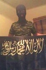 Five days before the attack, Haider posted a photograph on Facebook of himself wearing a balaclava and holding the Shahada flag.