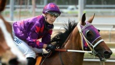 Jockey Carly Mae-Pye on the racetrack.
