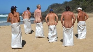 Competitors enjoy the sack race during Nudist Day at Alexandria Beach.