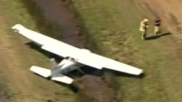 A plane lies to the side of a runway at Redcliffe Airport at Rothwell.