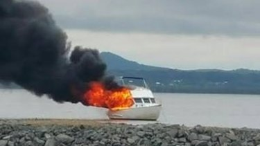 A man was taken to hospital after this boat fire on Redland Bay on Monday morning.