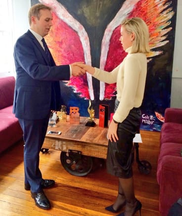 """""""The Royal Butler"""" demonstrating a handshake fit for the Queen with Fairfax Media reporter Amy Croffey."""
