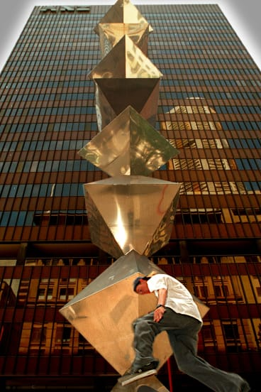 """Bert Flugelman's """"shish kebab"""" statue came of age on being moved, mid-1990s, to the corner of Pitt and Spring streets, Sydney."""
