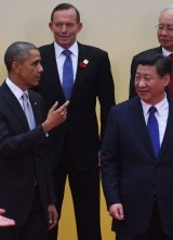Lonely stand: Prime Minister Tony Abbott stands behind US President Barack Obama and Chinese Present Xi Jinping.