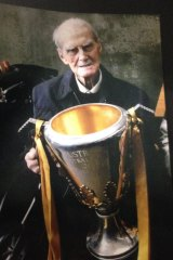 Ken Feltscheer with the 2014 Hawthorn premiership cup.