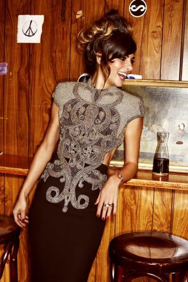 Colloca wears a dress by Steven Khalil.