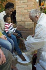Pope Francis washes the feet of a prisoner's child at Rebibbia's jail in Rome.
