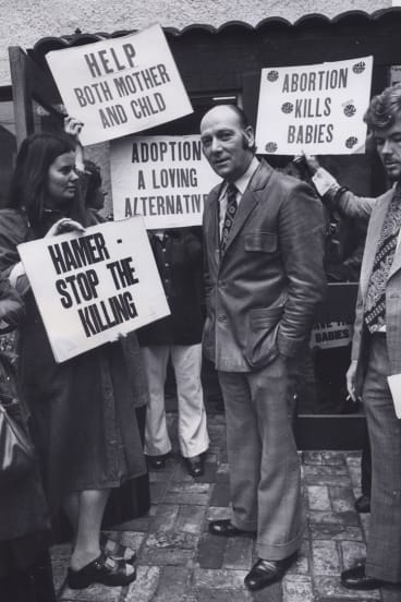 Protests outside the East Melbourne clinic have been going for decades. This photo, taken in 1976, shows Dr Bertram Wainer, who campaigned for the decriminalisation of abortion, surrounded by Right to Life protesters.