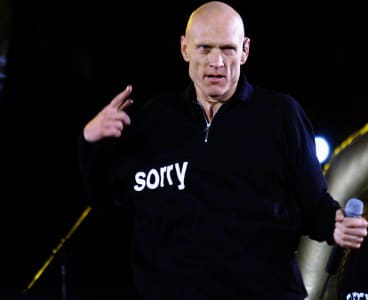 Peter Garrett performs with Midnight Oil at the closing ceremony of the Sydney Olympics.