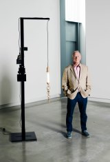 Michael Buxton, in the Buxton Contemporary museum, by Mikala Dwyer sculpture, Black lamp with Madonna and magnetic sculpture, 2011 (mixed media, 256cm X 50cm X 50cm).