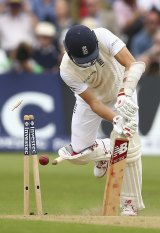 England's Mark Wood is yorked by Starc.