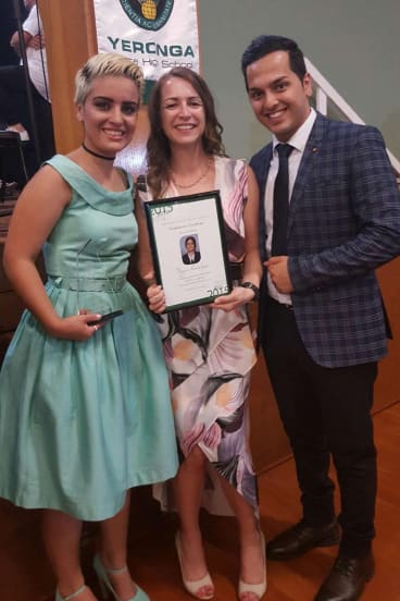Asylum seeker Mojgan Shamsalipoor accepts her Year 12 certificate at the Yeronga State High School awards night.