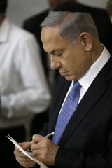 Israeli Prime Minister Benjamin Netanyahu prepares to deliver a speech after winning the election.