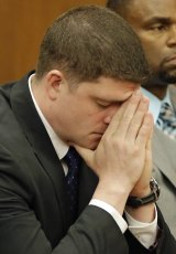 Michael Brelo reacts after he was acquitted of the manslaughter of two unarmed people in Cleveland.