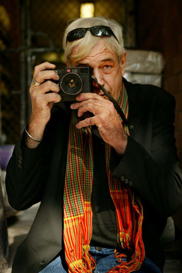 Photojournalist Tim Page, who  has covered major conflicts including the Vietnam war, with his Leica camera.