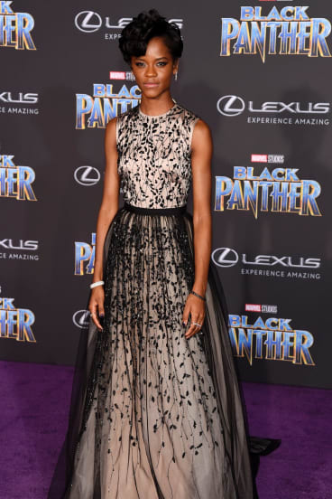 Letitia Wright, a cast member in Black Panther, poses at the premiere of the film at The Dolby Theatre in Los Angeles.