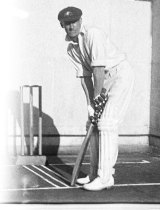 Donald Bradman relaxed as the bowler approaches the crease.