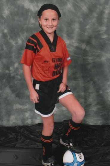"""Rae Anderson, posing for a soccer team photo, says people should be themselves and """"do what you want to do""""."""