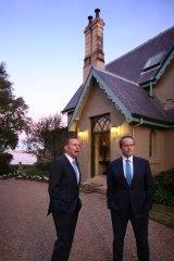 Prime Minister Tony Abbott and Opposition Leader Bill Shorten greet guests at Kirribilli House.
