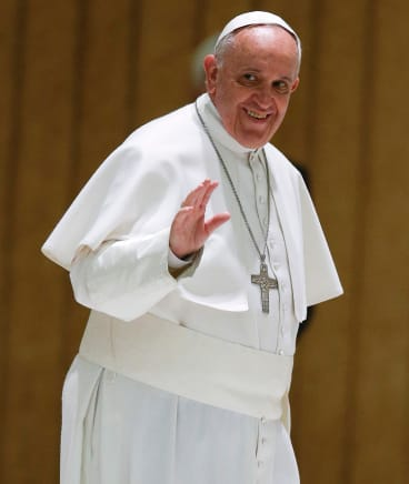 Pope Francis waves to the faithful at the Vatican.
