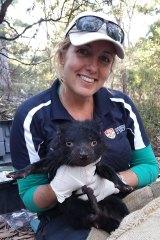 Carolyn Hogg with a Tasmanian devil on Maria Island in March 2017.