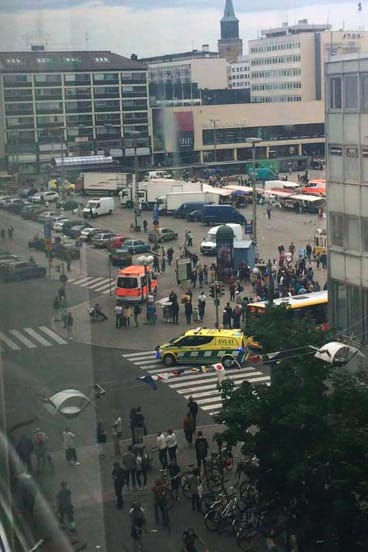 Emergency services working in Turku Market Square in Finland on Friday.