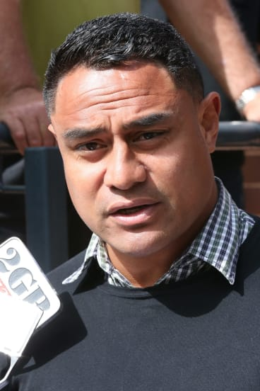 """We are truly sorry"": Joe Galuvao reads a statement to the media outside the court."