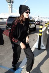 Kaia Jordan Gerber rocks a beanie and tracksuit at Los Angeles International Airport.