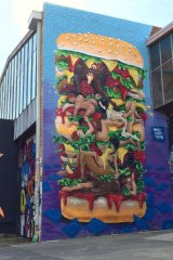 The Kama Sutra burger mural in Brunswick.