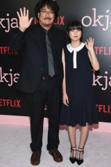 Director, co-screenwriter and producer Bong Joon Ho and actress Ahn Seo-Hyun at the premiere of Okja in New York.
