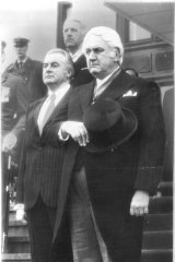 In happier times: Sir John Kerr arrives at Parliament House to be sworn in as governor-general in 1974 as prime minister Gough Whitlam looks on.