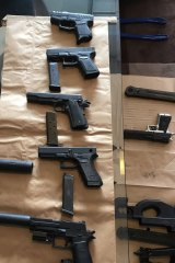 Most of the replica firearms allegedly seized by police.