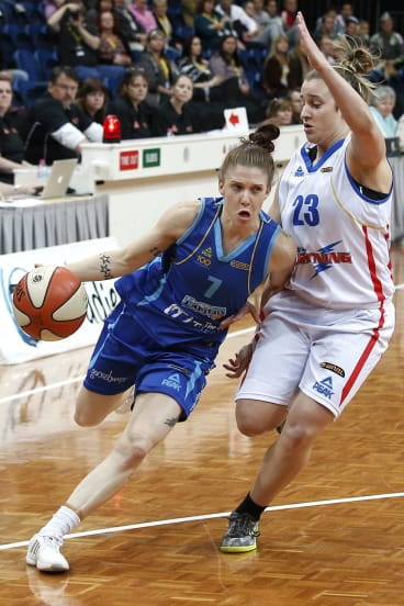 Former Adelaide Lightning player Lauren Mansfield, right, takes on her new team Canberra Capitals in 2013.