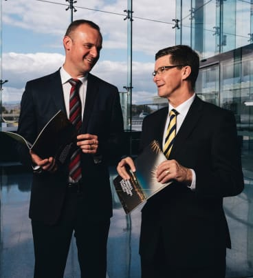 Andrew Barr with Brendan Smyth last year. Mr Barr's appointment of Mr Smyth, a Liberal politician, as International Engagement Commissioner, created tension in the public service.