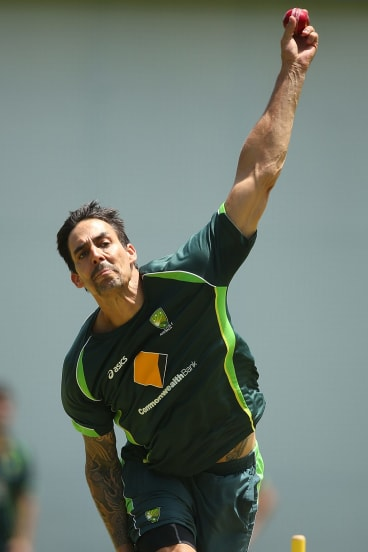 Mitchell Johnson bowls in the nets at the Gabba.