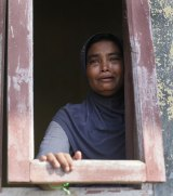 A Rohingya woman weeps  at a temporary shelter in Lapang, Aceh province, Indonesia,  in May.