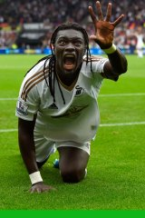 Striker Bafetimbi Gomis celebrates after scoring Swansea's second goal against Manchester United on Sunday.