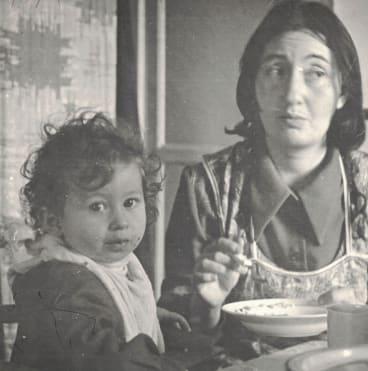 The writer as a child with her mother.