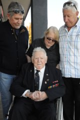 Veteran George McAulay, surrounded by family.