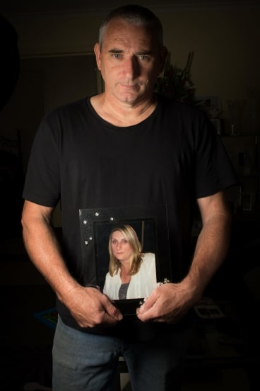 Jamie Hare holding a picture of his partner Linda who died in 2010.