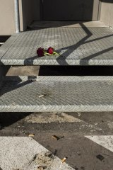 Roses lay on the stairs at the Bankstown carpark.
