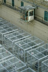 Guards in an elevated platform keep watch on caged prisoners in the excercise yard of the adjustment centre at San Quentin Prison in California.