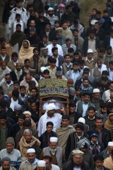 Execution: Villagers carry the body of executed militant and former soldier Arshad Mehmood to his grave.